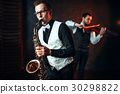 Sax man and fiddler duet playing classical melody 30298822