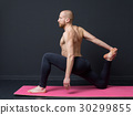 Young man  is doing front lunge 30299855