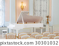 white grand piano on concert hall with chairs 30301032