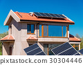 Solar panel on a red roof  30304446