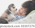Cute asian child playing with siberian husky puppy 30307274