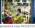 A woman working in a flower shop 30310724