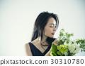 Female portrait with bouquet 30310780