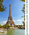 The Eiffel tower from the river Seine in Paris 30316596