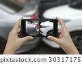 Hand holding phone take a photo at car crash 30317175