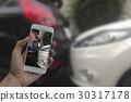 Hand holding phone take a photo at car crash 30317178