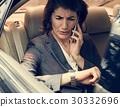 Businesswoman Talking Using Phone Car Inside 30332696