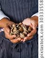 chef handing shiitake 30333558