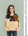 Woman Studio Portriat Casual Carrying a Box Isolated 30334215