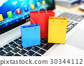Group of color paper shopping bags laptop keyboard 30344112