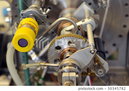 detail of parts of laboratory machine with gear 30345782