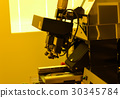 microscope in laboratory under the yellow light  30345784