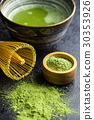 Green matcha tea powder with bamboo whisk . 30353926