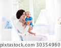 Mother and baby in bedroom 30354960