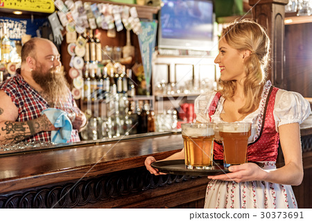 Outgoing young female speaking with man in bar 30373691