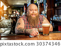 Bearded male leaning on workplace in pub 30374346