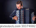 Playing the accordion 30374682