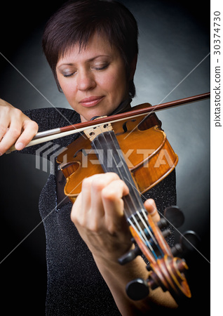 Musician playing violin 30374730
