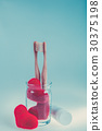 dental brushes in glass Valentine day. 30375198
