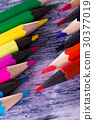 Set of color pencils on wooden background. Macro 30377019