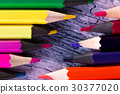 Set of color pencils on wooden background. Macro 30377020