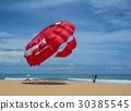 People playing parasailing in Phuket, Thailand. 30385545