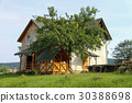 Modern cottage with wooden porch and veranda 30388698