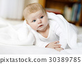 Baby girl wearing white towel or winter overal in 30389785