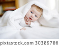 Baby girl wearing white towel or winter overal in 30389786