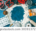 Baking flour frame on dark blue with ingredients 30391372