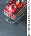 Fresh red fruit berries supermarket cart on black 30391375