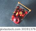 Fresh red fruit berries supermarket cart on black 30391376