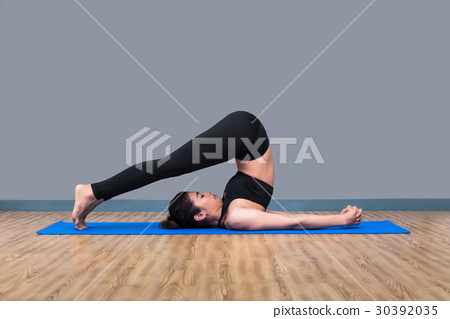 Young asian woman practicing yoga pose 30392035