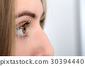 close-up of a womans eye 30394440