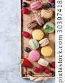 Variety of french dessert macaroons 30397418