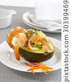 Avocado stuffed with shrimps and vegetables. 30399469