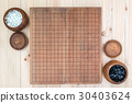 two wooden bowls with empty go game board 30403624