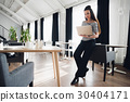 Picture of a beautiful female using laptop while 30404171