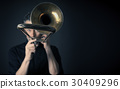 Dark portrait of a trombonist 30409296