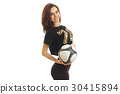 sports girl smiling on camera with soccer ball in 30415894