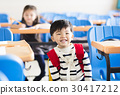 happy little boy student  in the classroom 30417212