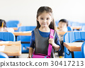 happy little girl student  in the classroom 30417213