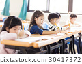 happy little girl studying  in the classroom 30417372