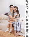 Happy mother and daughter hugging at home 30421699