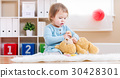Toddler girl have tea with her teddy bear 30428301