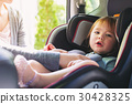 Toddler girl in her car seat 30428325
