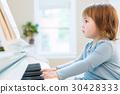 Toddler girl playing piano 30428333