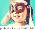 Happy toddler girl in pilot glasses 30428341