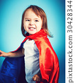 Toddler girl playing in a super hero cape 30428344