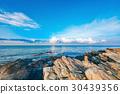 Rocky seashore in sunrise with bright blue sky 30439356